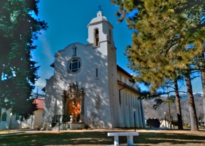 The Pauline Chapel, built in 1918, is a notable example of the Spanish Colonial Revival style.